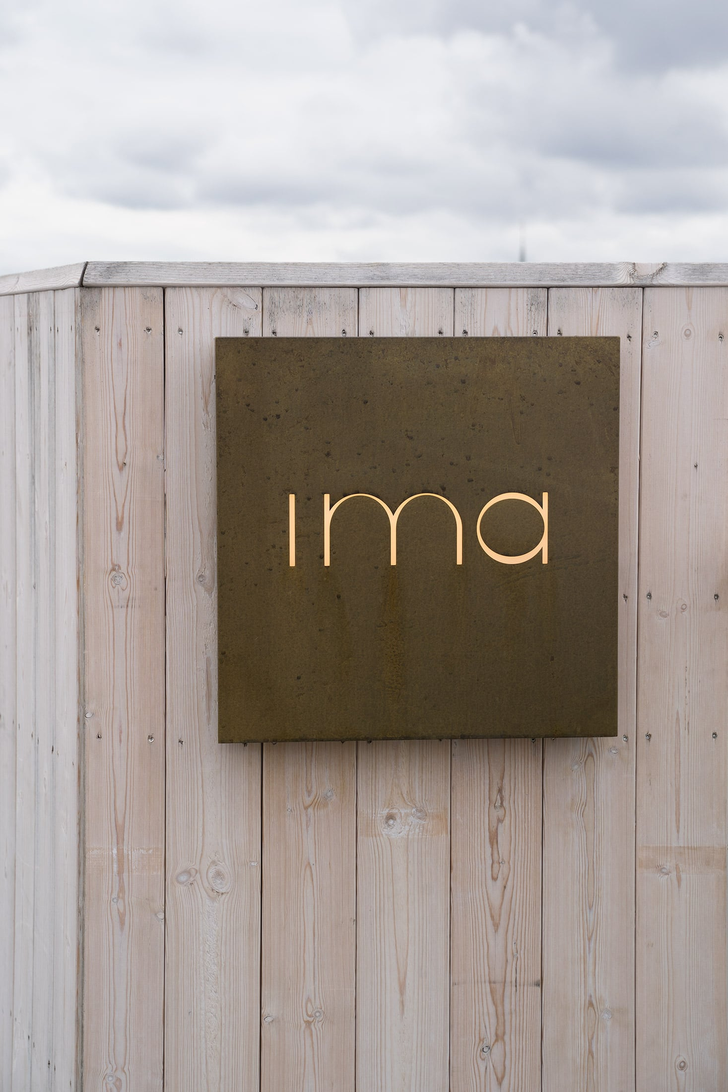 Behind the Amusement Park – IMA signage